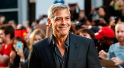 Actor George Clooney arrives on the red carpet for the film