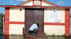 Pastor Louicesse Dorsaint opens the door to his church Haitian United Evangelical Mission which was damaged by flooding from Hurricane Irma in Immokalee, Florida, U.S. September 12, 2017. REUTERS/Stephen Yang