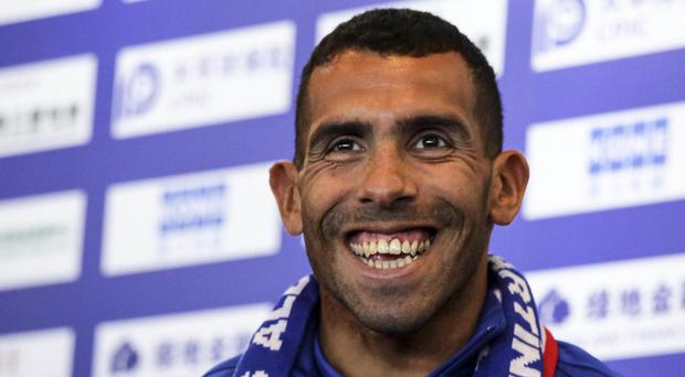 Carlos Tevez was unveiled as a Shanghai Shenhua player in January. AFP/Getty Images