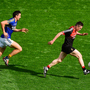 Mayo's Stephen Coen races clear of Kerry's Anthony Maher in their All-Ireland semi-final replay. Photo: Sportsfile