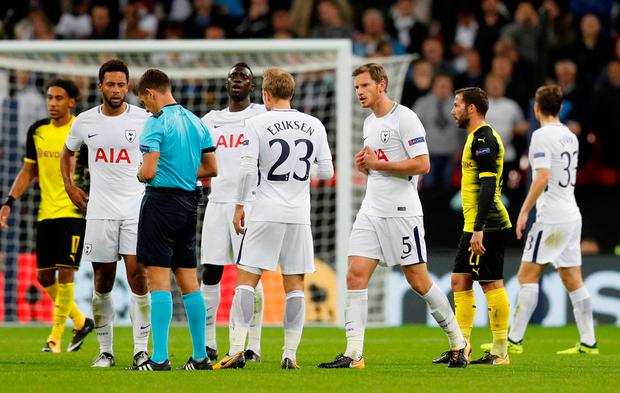 Tottenham's Jan Vertonghen is shown a red card by referee Gianluca Rocchi. Photo: REUTERS
