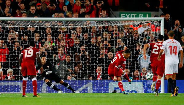 Roberto Firmino hits the post from the penalty spot. Photo: REUTERS