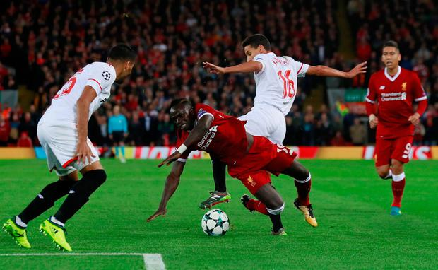 Liverpool's Sadio Mane tumbles after a challenge from Sevilla's Jesus Navas. Photo: REUTERS