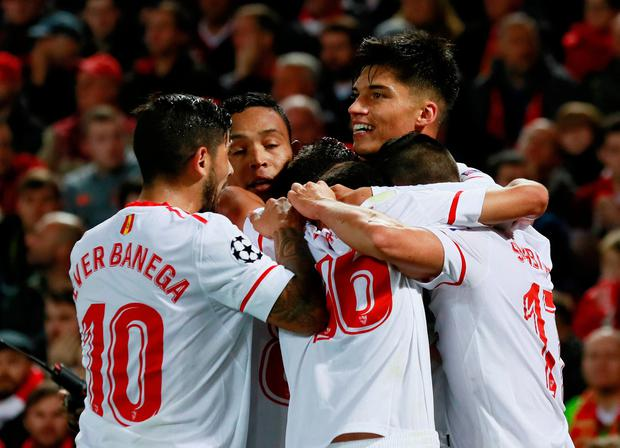 Joaquin Correa celebrates scoring Sevilla's equaliser with Ever Banega and team mates. Photo: REUTERS