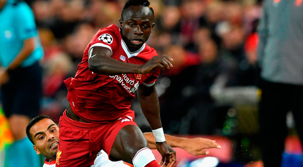 Sadio Mane gets away from Gabriel Mercado during the 2-2 draw at Anfield last night. Photo: Getty Images