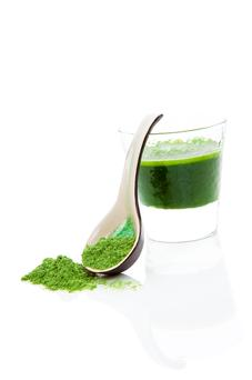 Green wheatgrass, spirulina and chlorella juice in a glass with wheat grass powder. Spirulina and chlorella were both found to contain faecal organisms in the study
