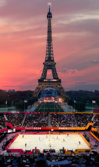 This computer-generated image provided by Paris 2024 shows the beach volleyball venue in front of the Eiffel Tower in Paris.