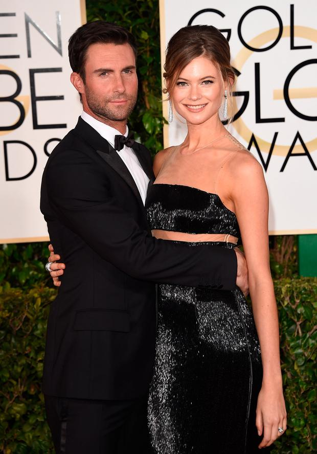 Singer Adam Levine and model Behati Prinsloo attend the 72nd Annual Golden Globe Awards at The Beverly Hilton Hotel on January 11, 2015 in Beverly Hills, California. (Photo by Jason Merritt/Getty Images)