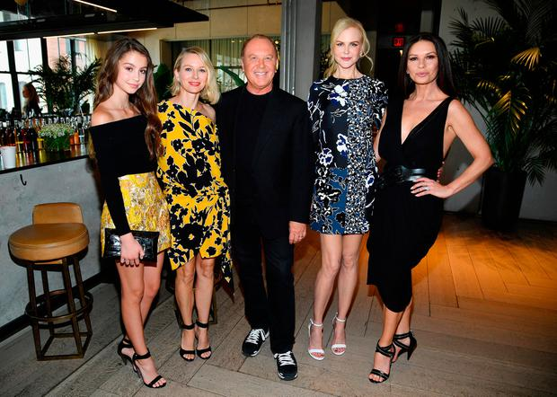 (L-R) Carys Zeta Douglas, Naomi Watts, Michael Kors, Nicole Kidman and Catherine Zeta-Jones pose backstage at Michael Kors Collection Spring 2018 Runway Show at Spring Studios on September 13, 2017 in New York City. (Photo by Dimitrios Kambouris/Getty Images for Michael Kors)