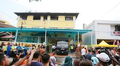 Malaysian police truck waits outside an Islamic religious school following a fire on the outskirts of Kuala Lumpur Thursday, Sept. 14, 2017. (AP Photo/Daniel Chan)