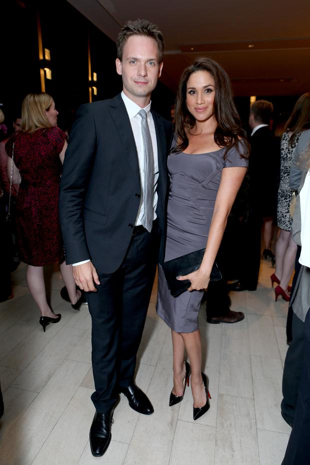 Actors Patrick J. Adams (L) and Meghan Markle attend the FINCA Canada Fundraiser At TIFF 2012 during the Toronto International Film Festival on September 11, 2012 in Toronto, Canada. (Photo by Alexandra Wyman/Getty Images For FINCA)