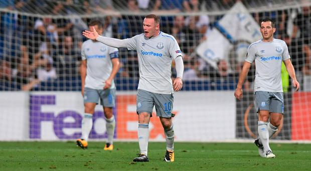 Leighton Baines looks as Wayne Rooney vents his frustration after Atalanta's second goal. Photo: Alberto Lingria/Reuters