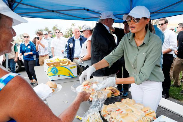 U.S. First Lady Melania Trump (R) and President Donald Trump hand out sandwiches to Hurricane Irma victims during their tour of storm recovery efforts in Naples, Florida, U.S. REUTERS/Jonathan Ernst