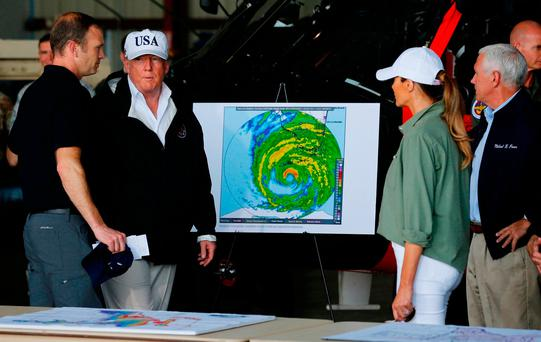President Trump receives a briefing on Hurricane Irma relief efforts from Federal Emergency Management Agency (FEMA) Administrator Brock Long (left) as the president arrives to tour storm damage with first lady Melania Trump (second right) and Vice President Mike Pence (right) in Fort Myers, Florida. Photo: Reuters