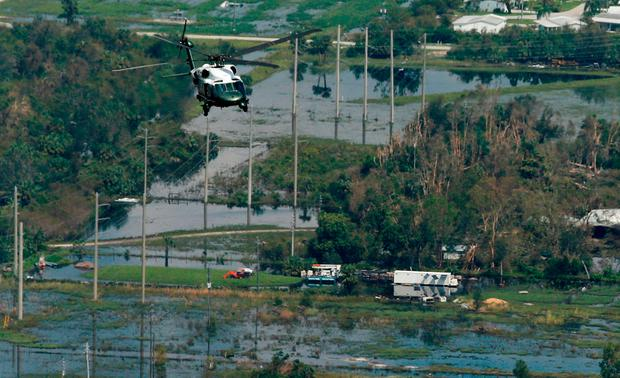 President Trump flies aboard the Marine One helicopter over storm damage and flooding caused by Hurricane Irma near Fort Myers, Florida. Photo: Reuters