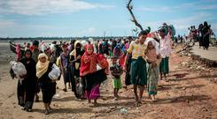 Rohingya after arriving on a boat to Bangladesh yesterday in Shah Porir Dip. Photo: Allison Joyce/Getty Images