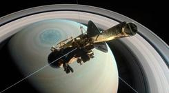 NASA illustration of Cassini above Saturn's northern hemisphere prior to making one of its Grand Finale dives. Photo: NASA/PA