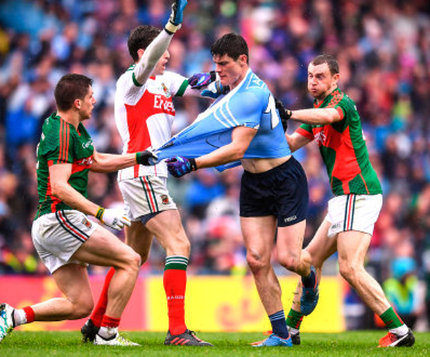 Dublin's Diarmuid Connolly has his jersey pulled by Mayo's Lee Keegan as David Clarke and Keith Higgins close in during last year's drawn All-Ireland SFC final. Photo: Stephen McCarthy/Sportsfile