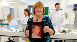 Maureen Kelly at the opening of the new laboratory in the Mater Hospital, holding a picture of her son Darragh, who died of Sudden Adult Death Syndrome. Photo: Caroline Quinn