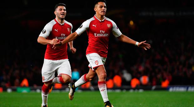 Alexis Sanchez of Arsenal celebrates scoring the 2nd arsenal goal with Sead Kolasinac of Arsenal during the UEFA Europa League group H match between Arsenal FC and 1. FC Koeln at Emirates Stadium