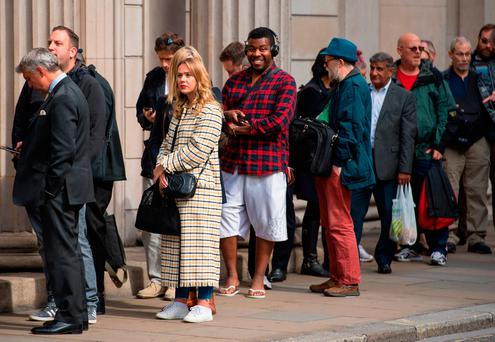 People queue outside the Bank of England in London, to exchange money for the new ten pound note featuring Jane Austen. Photo: PA