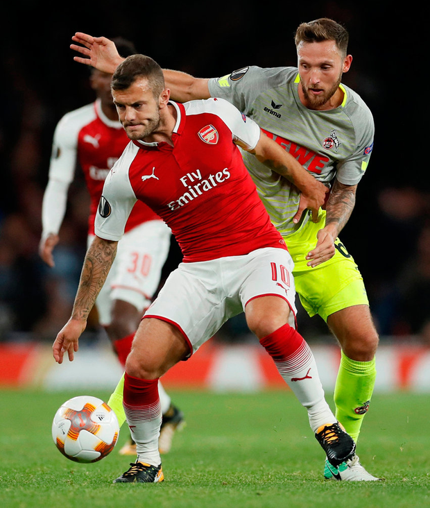 Arsenal's Jack Wilshere in action with FC Koln's Marco Hoger. Photo: David Klein/Reuters