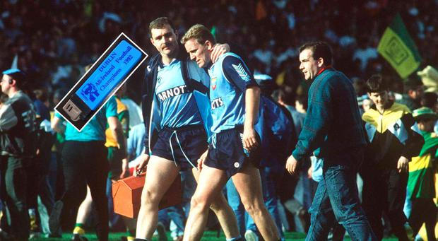 Dublin's Keith Barr is consoled by team-mate Ciaran Walsh in 1992 and (inset) the lighter