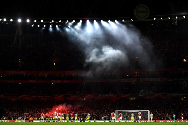 FC Koln Fans let of flares after Jhon Cordoba of FC Koeln scored the first goal during the UEFA Europa League group H match between Arsenal FC and 1. FC Koeln at Emirates Stadium on September 14, 2017 in London, United Kingdom. (Photo by Dan Mullan/Getty Images)