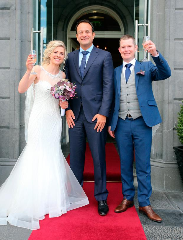 Taoiseach Leo Varadkar meets with newly weds Ian and Eleanor Walsh from Kilmacow county Kilkenny on the final day of the Fine Gael Parliamentary Party Meeting in the Minella Hotel, Clonmel, Co. Tipperary. Pic:Mark Condren