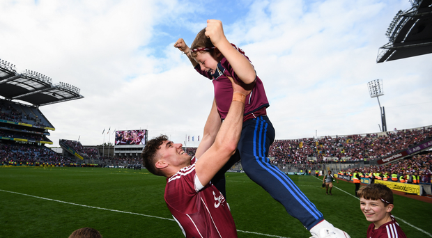 Jason Flynn of Galway celebrates with Jody Canning, nephew of Joe Canning, following the GAA Hurling All-Ireland Senior Championship Final match between Galway and Waterford at Croke Park in Dublin. Photo by Stephen McCarthy/Sportsfile