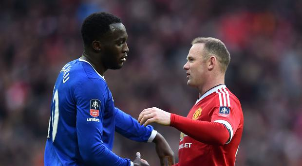Romelu Lukaku (L) embraces Wayne Rooney (R) after the final whistle of the English FA Cup semi-final football match between Everton and Manchester United at Wembley Stadium in London on April 23, 2016. (Photo credit: BEN STANSALL/AFP/Getty Images)