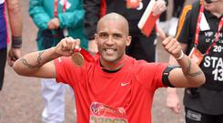 Clarke Carlisle finishes the Virgin London Marathon 2016 on April 24, 2016 in London, England. (Photo by Karwai Tang/WireImage)