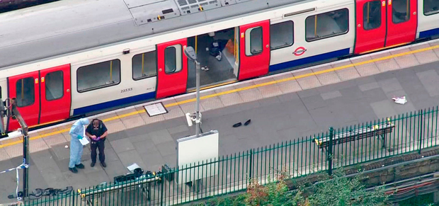 In this aerial image made from video, forensic officers work at the Parsons Green Underground Station after an explosion. A reported explosion at a train station sent commuters stampeding in panic, injuring several people at the height of London's morning rush hour, and police said they were investigating it as a terrorist attack. Photo: AP