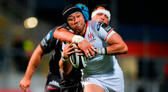 Christian Lealiifano of Ulster is tackled by John Barclay of Scarlets. Photo by Oliver McVeigh/Sportsfile