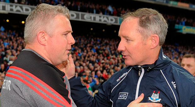 Mayo's Stephen Rochford and Jim Gavin shake hands after last year's All-Ireland final replay – the two managers will go head-to-head again at Croke Park tomorrow. Photo: Sportsfile