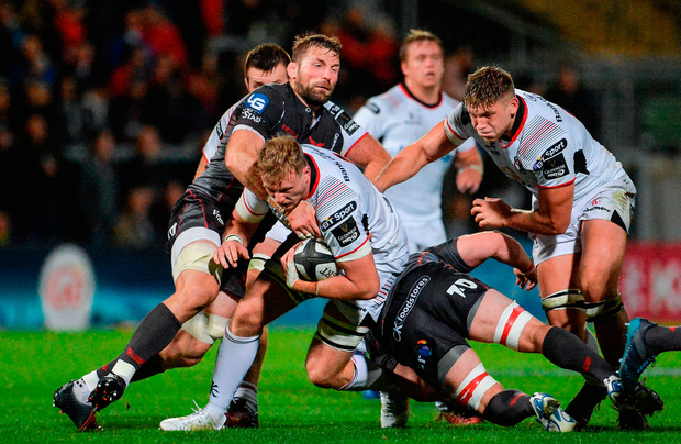 Kieran Treadwell of Ulster is tackled by Jake Ball, left, and Will Boyde of Scarlets. Photo by Oliver McVeigh/Sportsfile