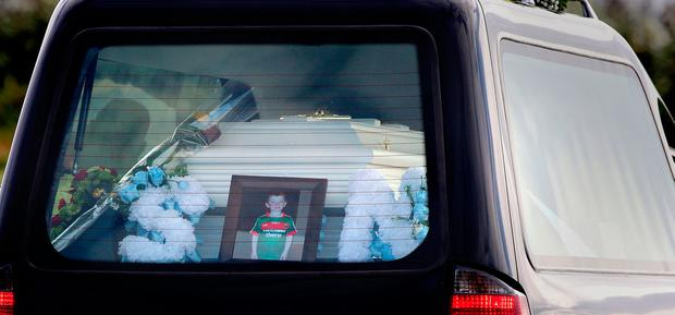 A photo of Sean Wilson beside his coffin in the hearse. Photo: Gerry Mooney
