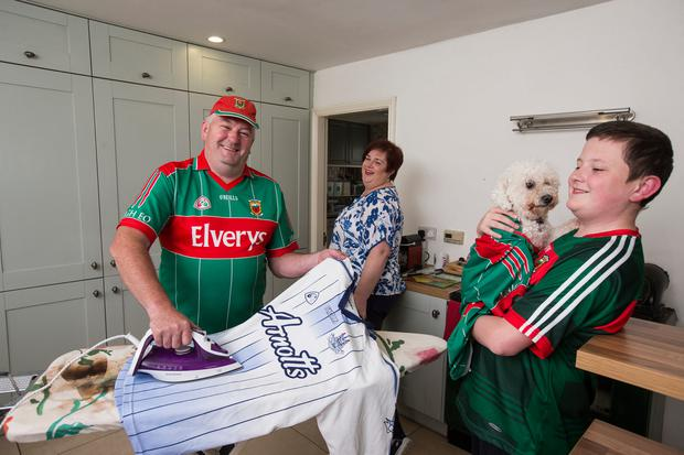 Michael Gill and wife Aisling (above) show off their colours Photo: Mark Condren