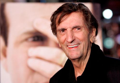 Cast member Harry Dean Stanton smiles at the premiere of