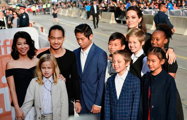 Vivienne Jolie-Pitt, front row from left, Knox Jolie-Pitt, Sareum Srey Moch, middle row from left, Loung Ung, Maddox Jolie-Pitt, Pax Jolie-Pitt, Kimhak Mun, Shiloh Jolie-Pitt, Zahara Jolie-Pitt and Angelina Jolie attend a premiere for