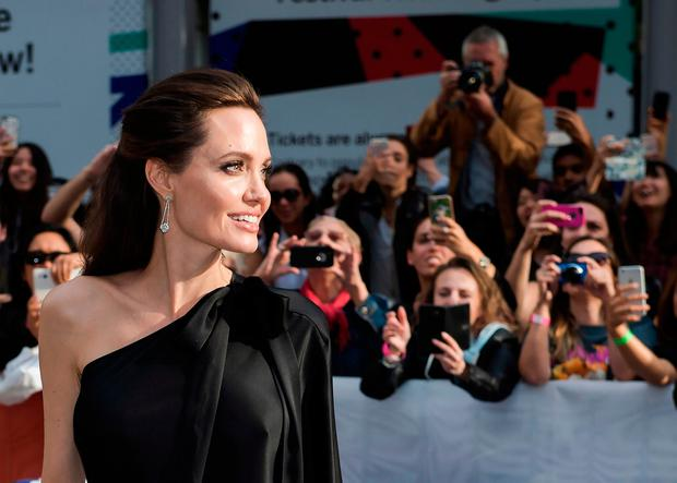 Director and actress Angelina Jolie arrives for the screening of