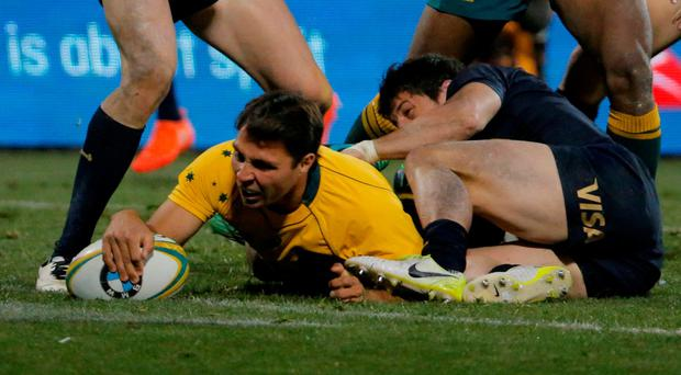 Australia's Nick Phipps scores a try. REUTERS/Jason Reed