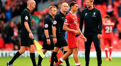 Liverpool manager Jurgen Klopp (right) tries to speak to referee Roger East after the final whistle