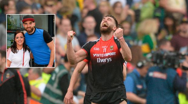 Aidan O'Shea celebrates beating Kerry in the semi-final replay and (inset) poses for a photograph with a fan