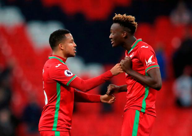 Swansea City's Martin Olsson (left) and Tammy Abraham after the final whistle