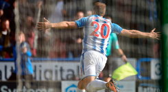 Huddersfield Town's Belgian striker Laurent Depoitre celebrates after scoring the opening goal. Photo: Getty Images