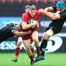 Chris Farrell of Munster is tackled by Ma'afu Fia, left, and Justin Tipuric of Ospreys. Photo: Sportsfile