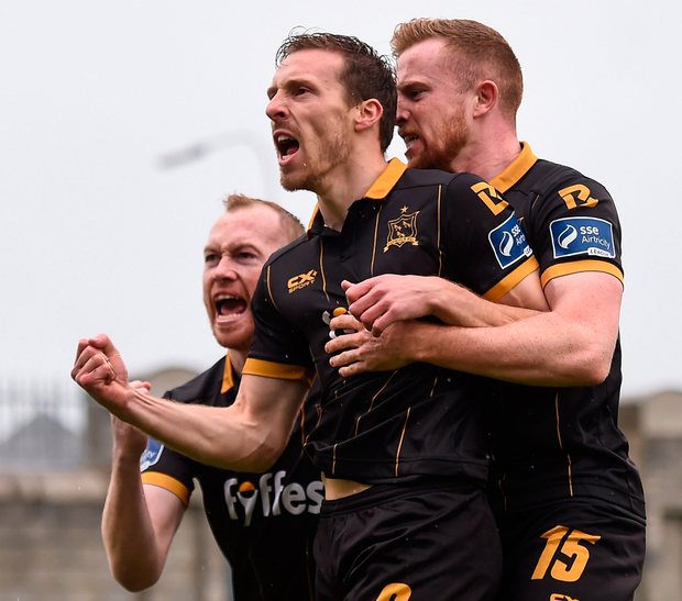 David McMillan celebrates with Dundalk team-mates Chris Shields, left, and Sean Hoare, right, after scoring his side's first goal during the EA Sports Cup Final between Shamrock Rovers and Dundalk at Tallaght Stadium in Dublin. Photo: Sportsfile