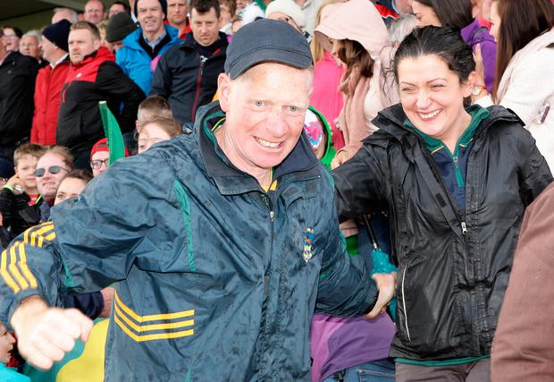 Kilmacabea's manager Kevin O'Driscoll celebrates with his wife Peggy. Photo: Paddy Feen