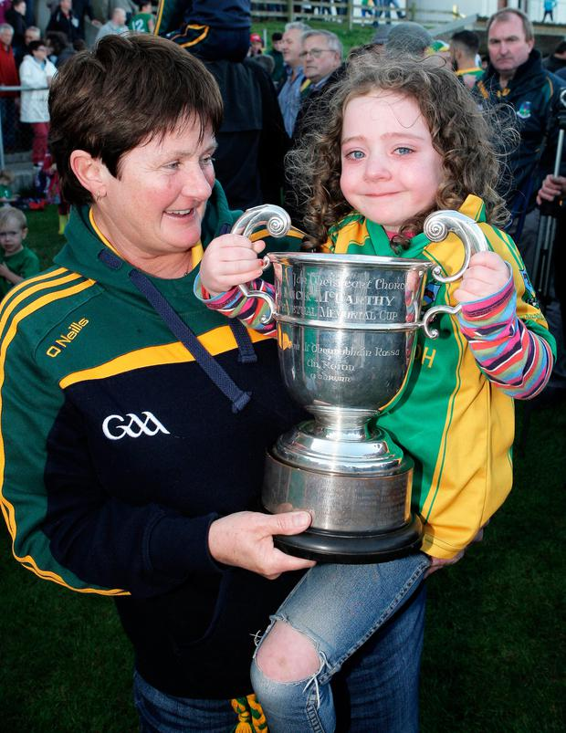 Mary Hayes and Kevin O'Driscoll's daughter Maggie holding the Mick McCarthy Cup. Photo: Paddy Feen